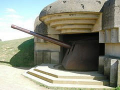 U.S. troops were met by German cannons embedded in the heavily fortified cement bunkers at Longues-sur-Mer
